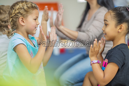 happy children and pre school teacher