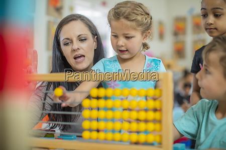 pre school teacher with children in