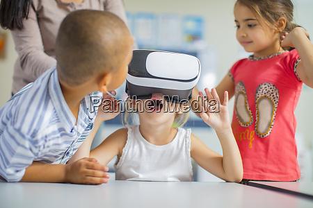 children in kindergarten with vr glasses