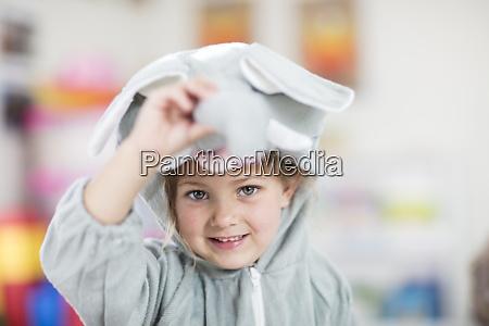 portrait of happy girl wearing elephant