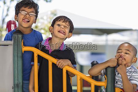 portrait of playful boys grimacing in
