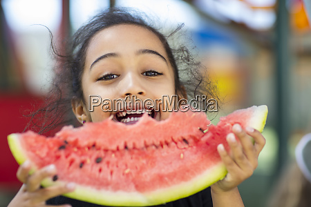 portrait of happy girl eating a