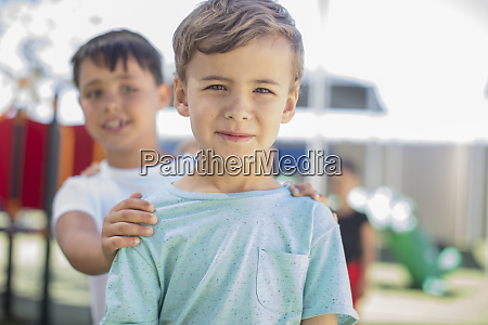 portrait of smiling boy with friends