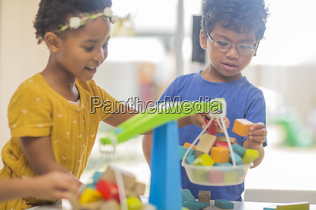 boy and girl playing with toy
