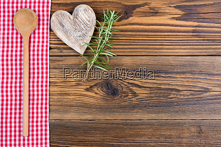 a wooden spoon rosemary twigs and