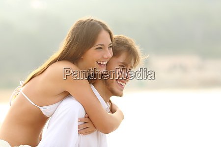 happy couple of teens on the