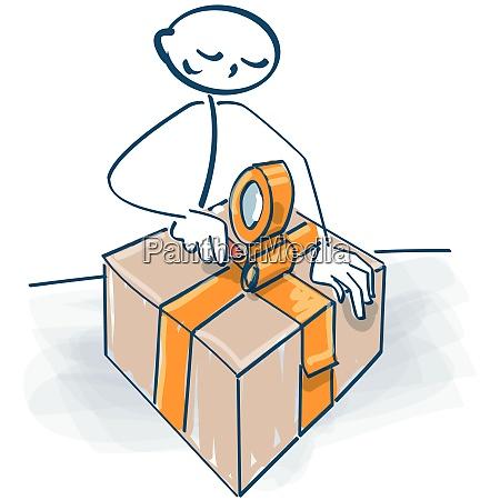 stickfigur packt ein paket mit einem