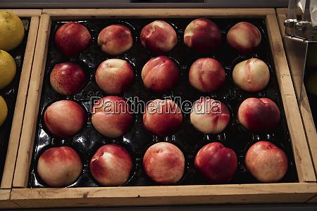 fresh peaches on display