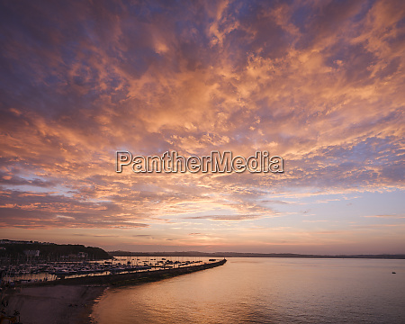 colourful sunset view of breakwater beach