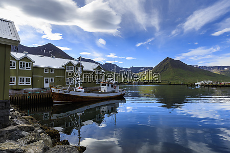 fishing boat hotel mountain and fjord