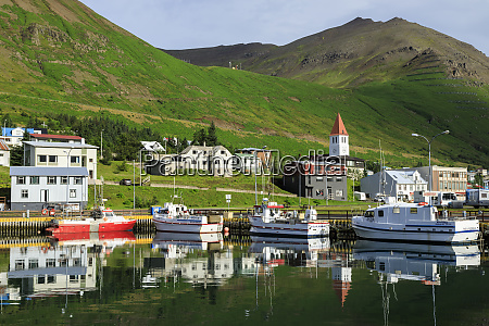 town mountains and fishing boats siglufjordur