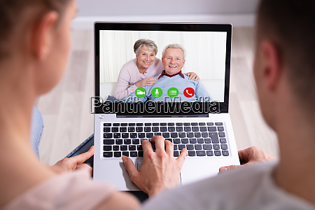 couple video conferencing with their parents