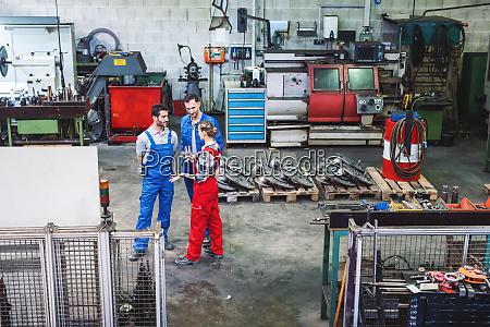 workers on the factory floor in