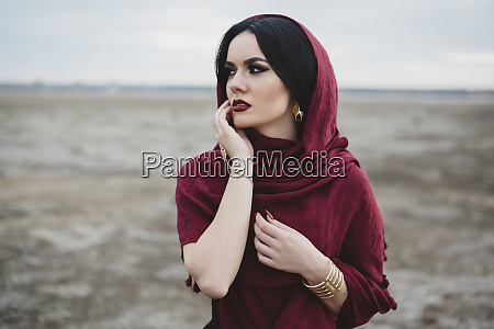 woman wearing red headscarf and lipstick