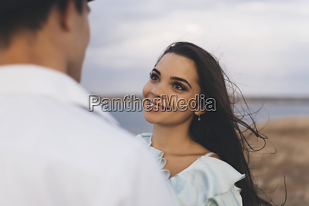 smiling young woman looking at her