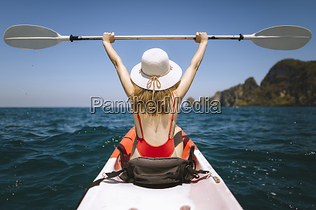 young woman in kayak on sea