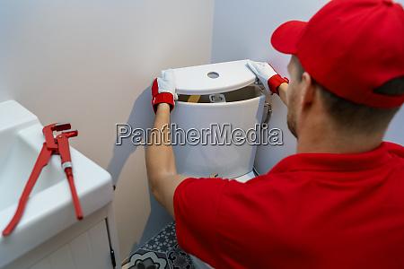 plumbing services plumber working in