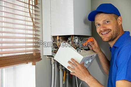 smiling maintenance and repair service engineer