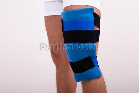 man wearing knee ice pack