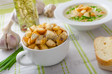 garlic soup with croutons spring onions
