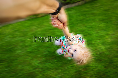 happy child is playing with parent