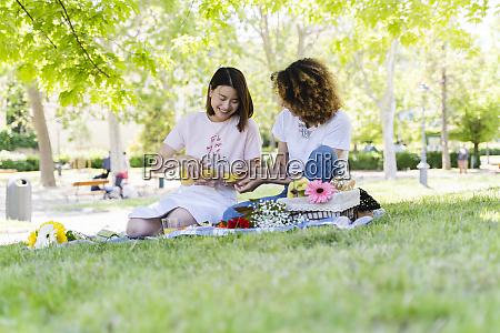 two happy women having a picnic