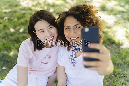 two happy women taking a selfie