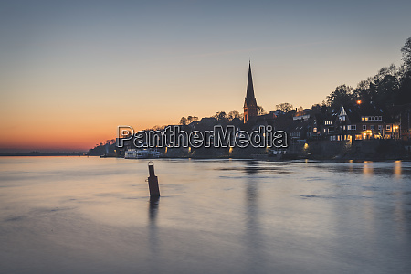 townscape with river elbe at sunset