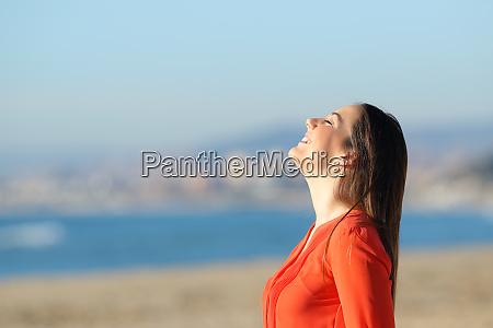 woman in orange breathing fresh air