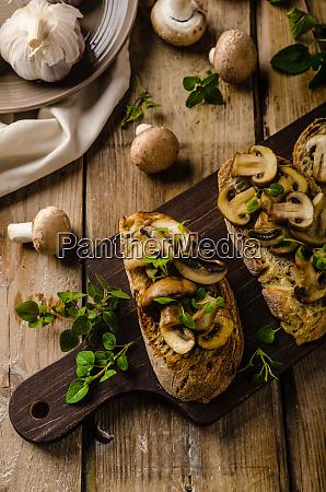 rustic toast bread with garlic mushrooms