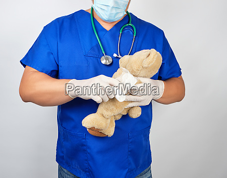 doctor in blue uniform bandages white