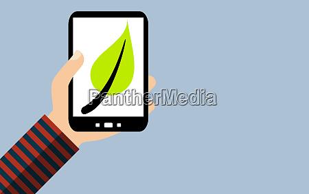 smartphone gruenes blattsymbol fuer nachhaltigkeit