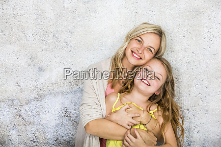 pretty blonde young mother poses and