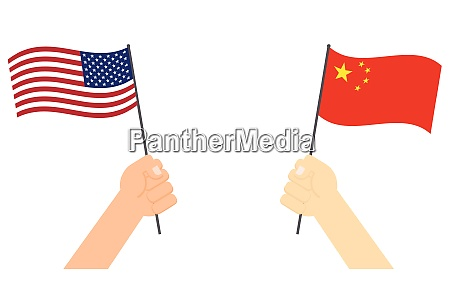 hands holding flag between usa and