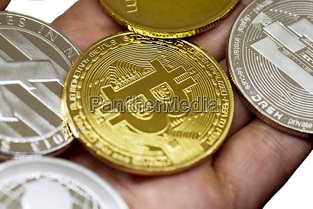 golden bitcoin in a man hand