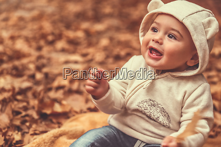 cute child in the autumn forest