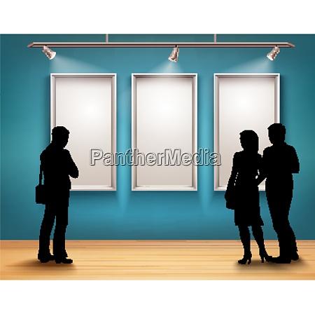 menschen silhouetten vor bilderrahmen in kunstgalerie