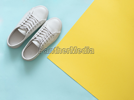 white sneakers on blue and yellow