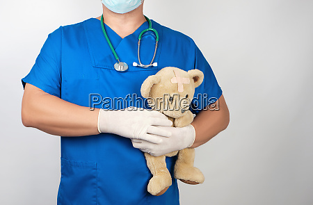 doctor in blue uniform and white