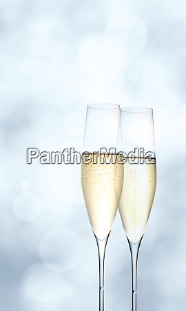 champagne glasses on bright blue background