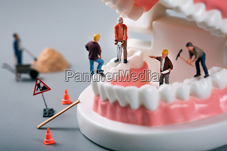 dental treatment concept construction workers