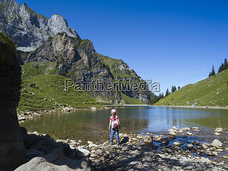 young girl hiking around bannalpsee in