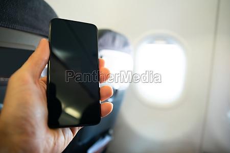 man hand holding mobilephone