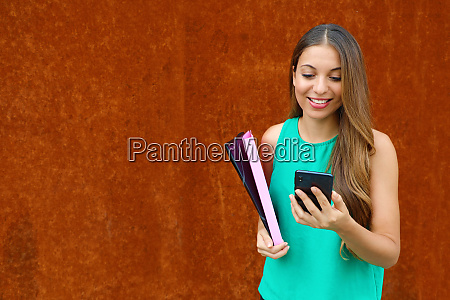 young business woman typing on smart