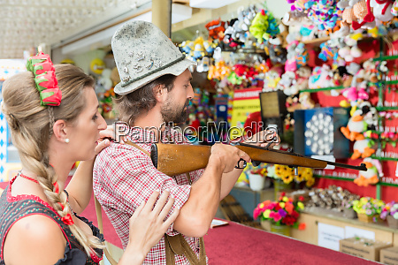 couple on bavarian fair at the