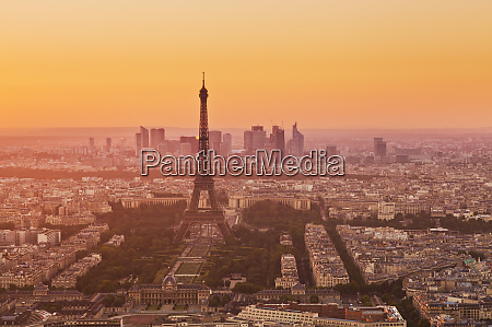 paris skyline at sunset with the
