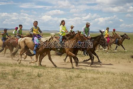 horse race with young mongolian jockeys