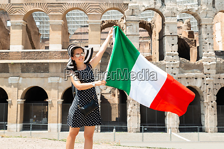 woman holding italian flag in front