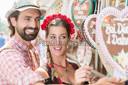 couple buying gingerbread hearts of bavarian
