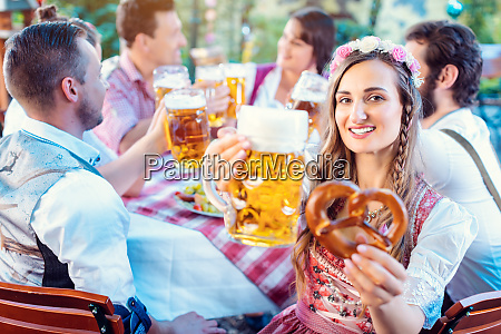 woman toasting to the camera with